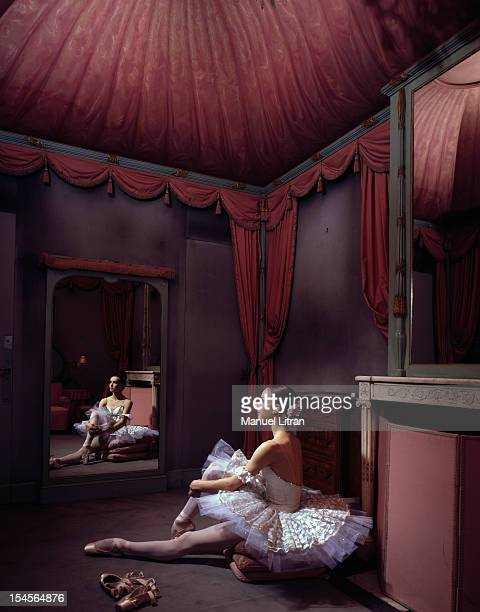 June 1985 Sylvie Guillem youngest star of the Paris Opera poses in the romantic tutu of 'Swan Lake' in the mirror of her dressing room
