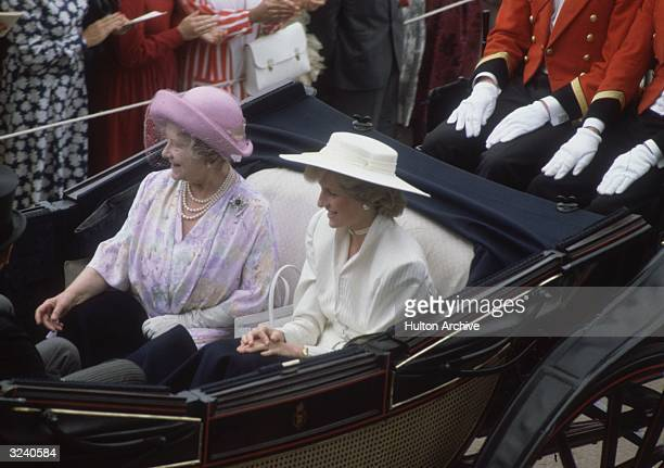 Elizabeth The Queen Mother and Princess Diana in an open top carriage at Ascot
