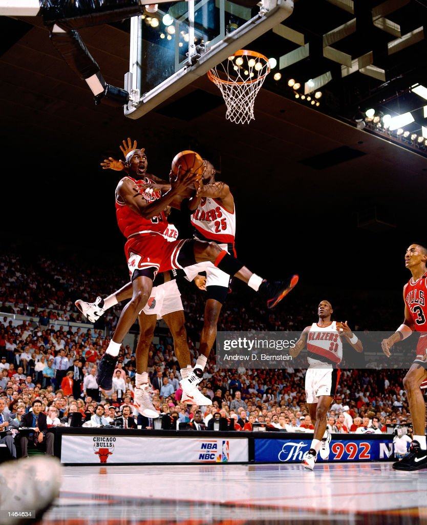 Michael Jordan of the Chicago Bulls attempts a reverse layup against Jerome Kersey of the Portland Trail Blazers during the 1992 NBA Finals in...