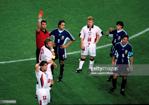 30 June 1998 Fifa World Cup England v Argentina Referee Kim Milton Nielsen shows the red card to David Beckham as Paul Scholes looks accusingly at...