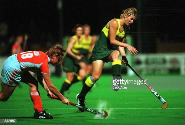 Australian ''Hockeyroo'' Julie Towers leaps to avoid a drive from Minke Booij of The Netherlands at the State Hockey Centre Brisbane Australia during...