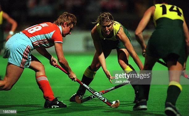 Minke Booij of The Netherlands and Australian ''Hockeyroo'' Julie Towers battle for the ball during their match at the State Hockey Centre Brisbane...