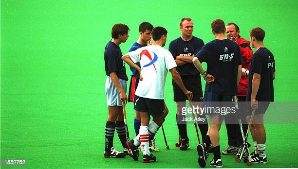 The England Mens Hockey team listen to coach Barry Dancer during the England Mens team training at the Sate Hockey Centre Brisbane Australia in...