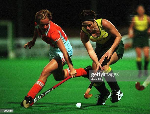 The Netherland's Minke Booij and Australian ''Hockeyroo'' Claire Mitchell Taverner battle for the ball during their match at the State Hockey Centre...