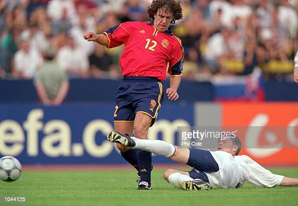 Carlos Puyol of Spain is tackled by Vratislav Gresko of Slovakia during the European Under 21's Championships 2000 at the Inter Stadium Bratislava...