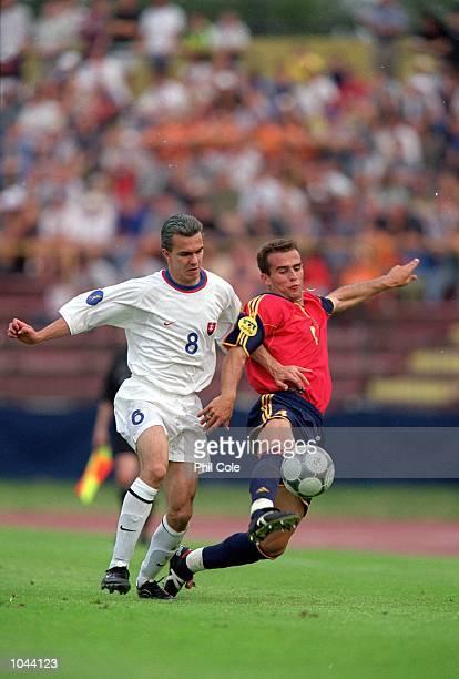 Ivan Amaya of Spain beats Szilard Nemeth of Slovakia to the ball during the European Under 21's Championships 2000 at the Inter Stadium Bratislava...