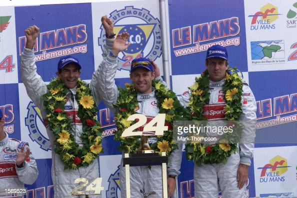 The winning Audi team celebrate victory at the Le Mans 24 Hour Race La Sarthe France Mandatory Credit Mark Thompson/ALLSPORT