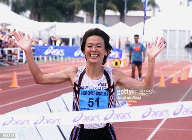 Yuko Arimori of Japan celebrates her victory in the Women's Gold Coast Marathon with a time of 235410 at the Runaway Bay Super Sports Centre Gold...