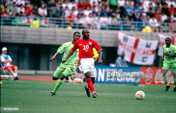 12 June 2002 FIFA World Cup Nigeria v England Darius Vassel of England passes the ball to a team mate after being pressured by James Obiaroah of...