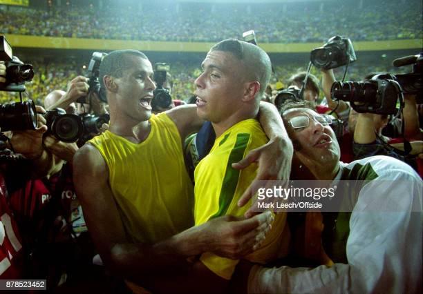 FIFA World Cup Final Brazil v Germany a fan invades the post match Brazil celebration between Rivaldo and Ronaldo