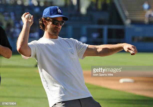 Justin Williams Conn Smythe Trophy winner and Stanley Cup champion player from the Los Angeles Kings throws a baseball to his son prior to a Major...