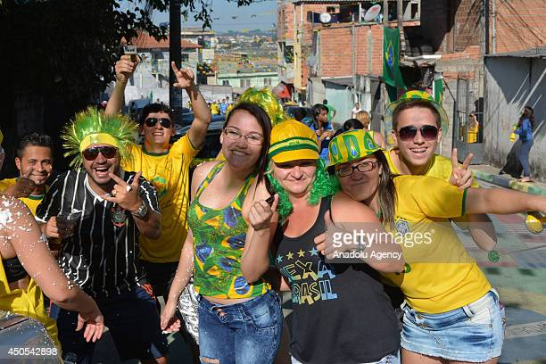 June 2014 Local people get into the World Cup spirit in a suburb near the Arena Corinthians World Cup stadium in Sao Paulo Brazil on June 13 2014