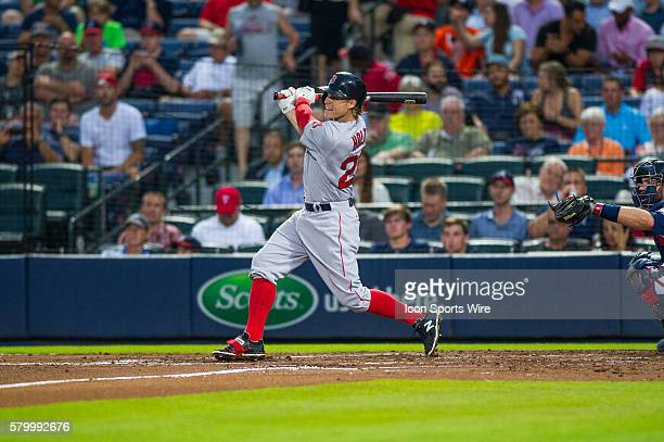 Boston Red Sox Second Baseman Brock Holt triples in the the fourth inning during a regular season game between the Boston Red Sox and the Atlanta...
