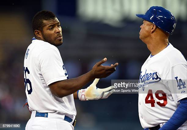 Los Angeles Dodgers Right field Yasiel Puig [9924] shrugs his shoulders after talking with third base coach Lorenzo Bundy during a Major League...