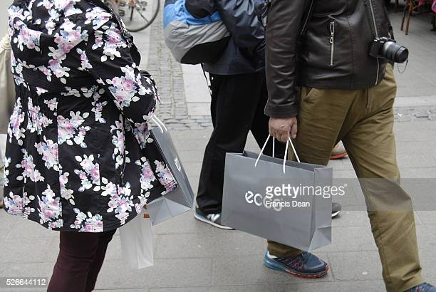 June 2015_Asian traveler shopper with Ecco bag shopping on streoget