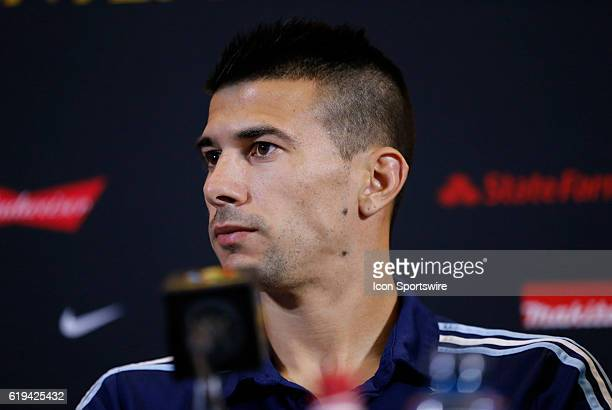 Argentina defender Victor Cuesta listens to a question at the press conference Argentina practiced in advance of their quarterfinal match against...