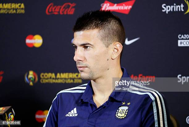 Argentina defender Victor Cuesta listens to a question during the press conference Argentina practiced in advance of their quarterfinal match against...