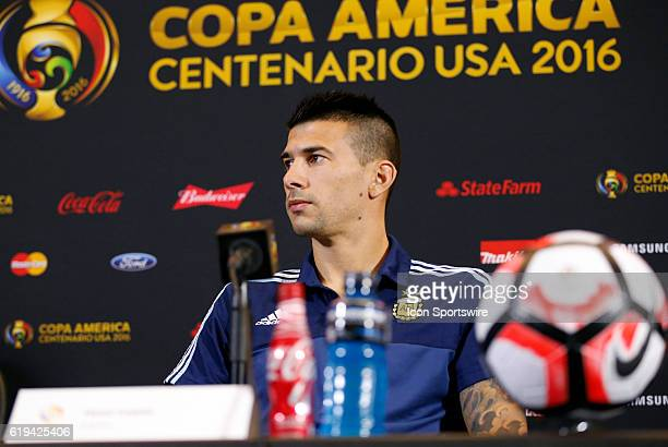 Argentina defender Victor Cuesta waits to answer a question at the press conference Argentina practiced in advance of their quarterfinal match...