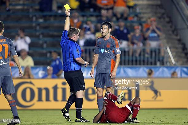 Carolina's Drew Beckie is shown the yellow card by referee Kevin Terry Jr for fouling Jordan McCrary The Carolina RailHawks hosted the New England...