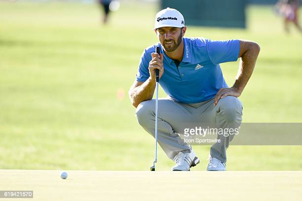 Dustin Johnson lines up a putt on the first green during the second round of the US Open at Oakmont Country Club in Pittsburgh Pa