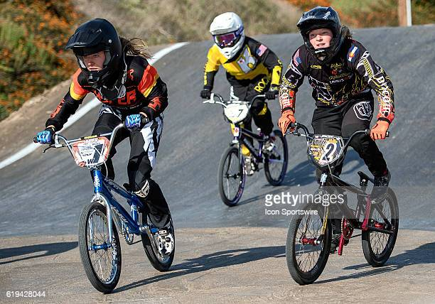 Hyper Bicycles' Jordan Scott and Factory Blaze's Ashley Hayes sprint into turn one during 14 Girls action on Day 1 of USA BMX's Hall of Fame...