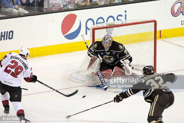Lake Erie Monsters RW Oliver Bjorkstrand shoots the puck on Hershey Bears G Justin Peters as Hershey Bears D Erik Burgdoerfer defends during the...