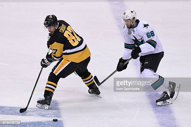Pittsburgh Penguins center Sidney Crosby plays the puck as San Jose Sharks right wing Melker Karlsson defends during the second The San Jose Sharks...