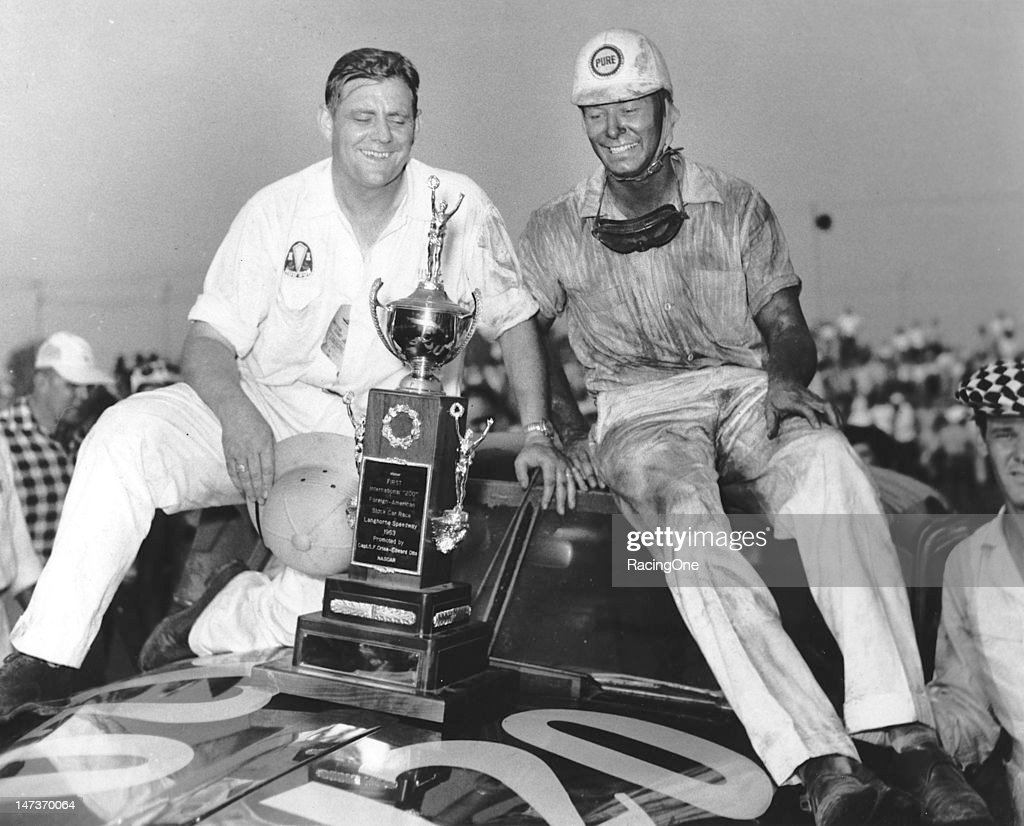 Car owner Walt Chapman joins his driver Dick Rathman in victory lane at Langhorne Speedway after Rathman won the International 200 NASCAR Cup race...