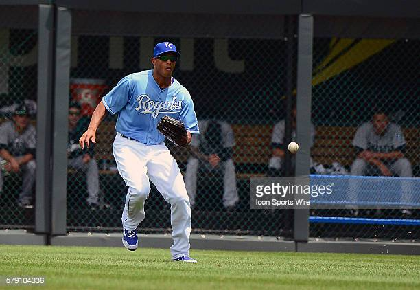 Kansas City Royals' rightfielder Justin Maxwell watches a ball hit by Seattle Mariners' shortstop Brad Miller drop in front of him for a single...