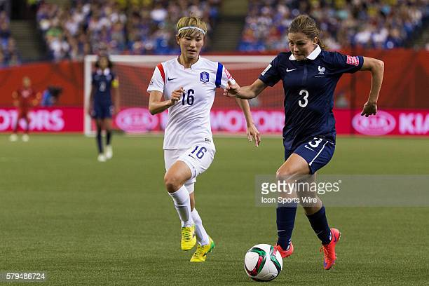 France defender Laure Boulleau controls the ball as Korea midfielder Kang Yumi defends during the 2015 FIFA Women's World Cup Round of 16 match...