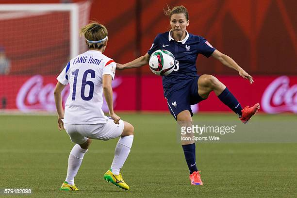 France defender Laure Boulleau controls the ball in front of Korea midfielder Kang Yumi during the 2015 FIFA Women's World Cup Round of 16 match...