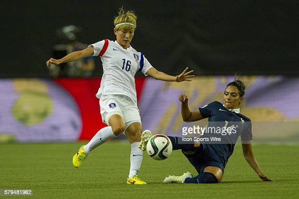 /Louisa Necib of France slide tackles Yumi Kang of the Korea Republic during the first half at the FIFA Women's World Cup 2015 Group of 16 match...
