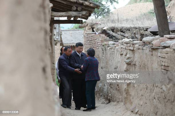 TAIYUAN June 21 2017 Chinese President Xi Jinping visits the povertystricken family of Wang Sannyu in Zhaojiawa Village of Kelan County in Xinzhou...