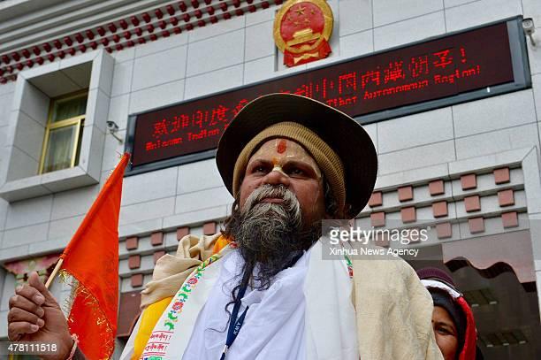 YADONG June 22 2015 An Indian national queues to enter Tibet Autonomous Region southwest China via Nathu La Pass on June 22 2015 China on Monday...