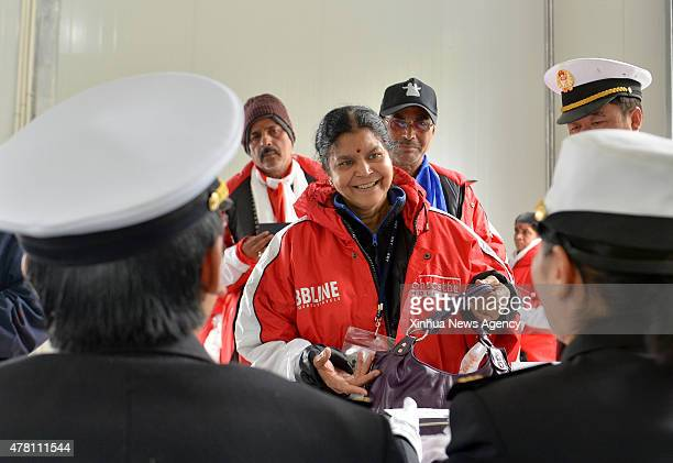 YADONG June 22 2015 Indian nationals queue to pass the Customs at Nathu La Pass southwest China's Tibet Autonomous Region June 22 2015 China on...