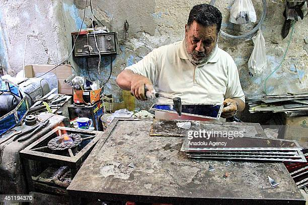 June 25 2014 dated pictures show the production of traditional lanterns also called fanous used by Egyptians for decoration during the holy month of...