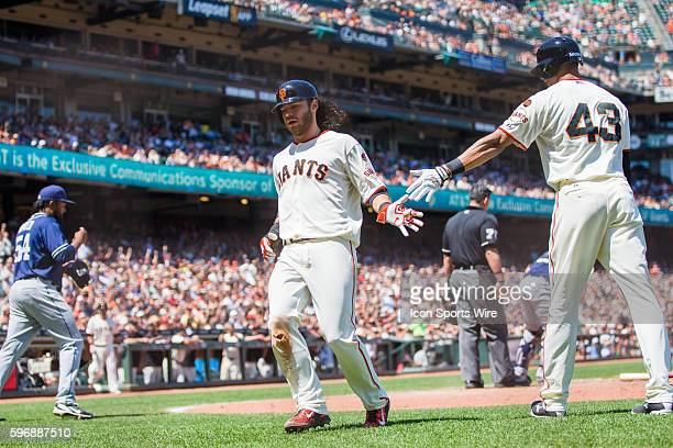 San Francisco Giants shortstop Brandon Crawford celebrates scoring with San Francisco Giants right fielder Justin Maxwell in the 7th inning during...