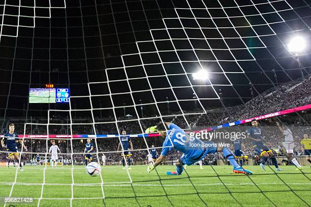 Los Angeles Galaxy goalkeeper Jaime Penedo dives unsuccessfully to save a shot on goal by San Jose Earthquakes midfielder Cordell Cato during the...