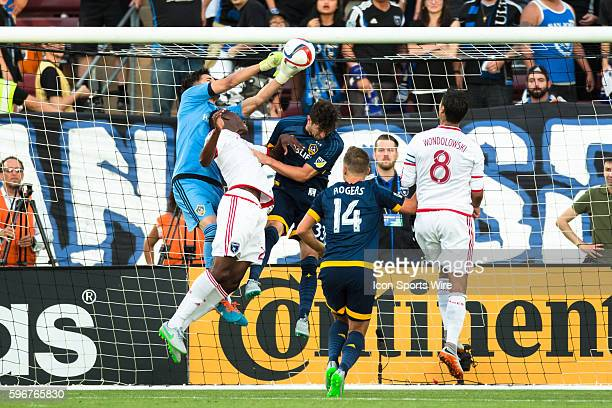 Los Angeles Galaxy goalkeeper Jaime Penedo pushes clear a shot on goal as San Jose Earthquakes midfielder Fatai Alashe and Los Angeles Galaxy...