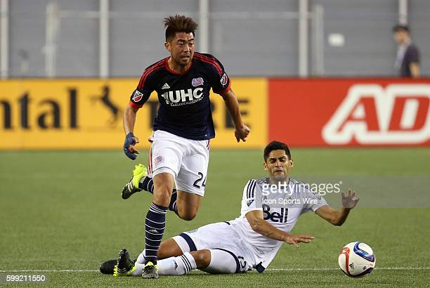 New England Revolution midfielder Lee Nguyen escapes from the sliding tackle of Vancouver Whitecaps midfielder Matias Laba The Vancouver Whitecaps...