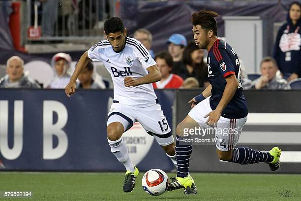 New England Revolution midfielder Lee Nguyen watched by Vancouver Whitecaps midfielder Matias Laba The Vancouver Whitecaps defeated the New England...