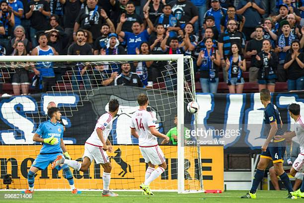 San Jose Earthquakes forward Chris Wondolowski takes a shot on goal to score as Los Angeles Galaxy goalkeeper Jaime Penedo defends during the game...