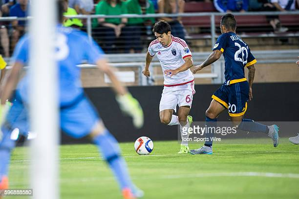 San Jose Earthquakes midfielder Shea Salinas turns to goal as Los Angeles Galaxy defender AJ DeLaGarza and Los Angeles Galaxy goalkeeper Jaime Penedo...
