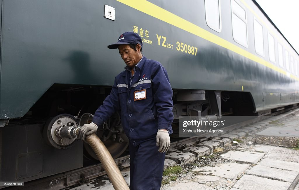 XINING, June 27, 2016 -- A worker discharge sewage from a train at the Golmud Station of the Qinghai-Tibet railway in Golmud, northwest China's Qinghai Province, May 26, 2016. The 1,956-kilometer-long Qinghai-Tibet railway, the world's highest altitude train line, has been put into service for 10 years. It links Lhasa, capital of southwest China's Tibet Autonomous Region, and Xining, capital of Qinghai Province in northwest China.