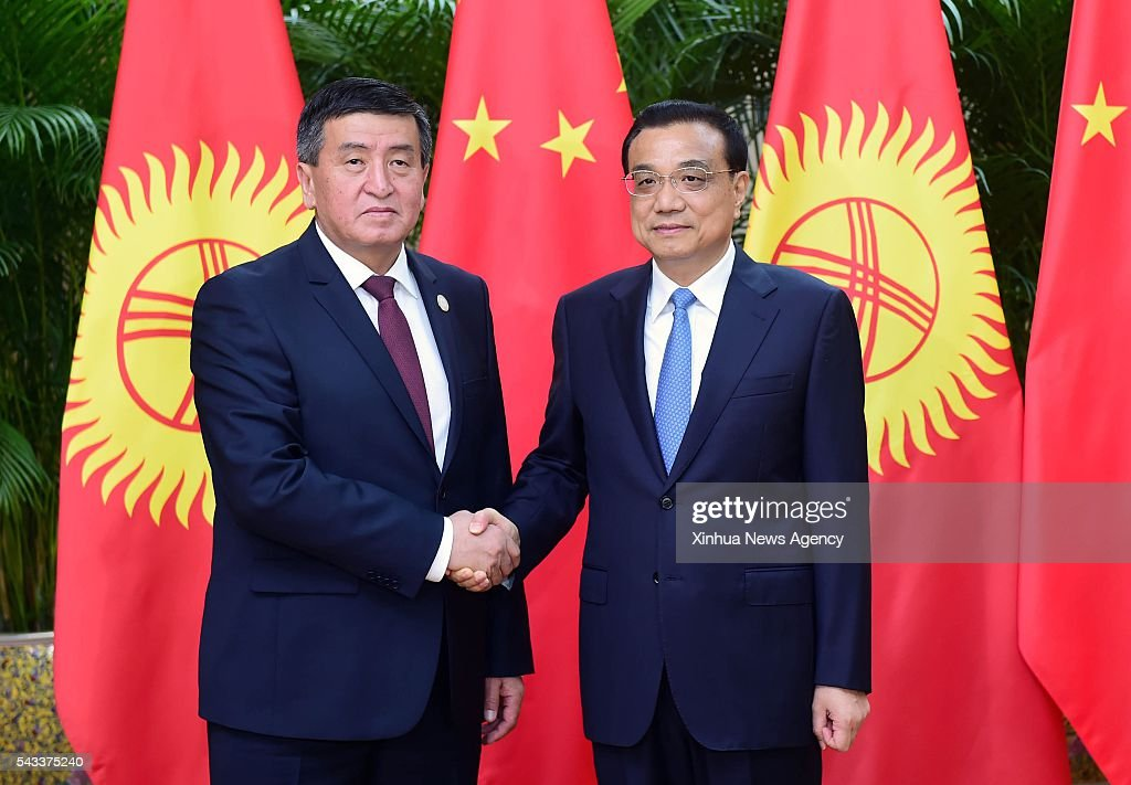 TIANJIN, June 27, 2016 -- Chinese Premier Li Keqiang, right, holds talks with Kyrgyz Prime Minister Sooronbai Zheenbekov, who is here to attend the Annual Meeting of the New Champions 2016, or Summer Davos Forum, in Tianjin, north China, June 27, 2016.