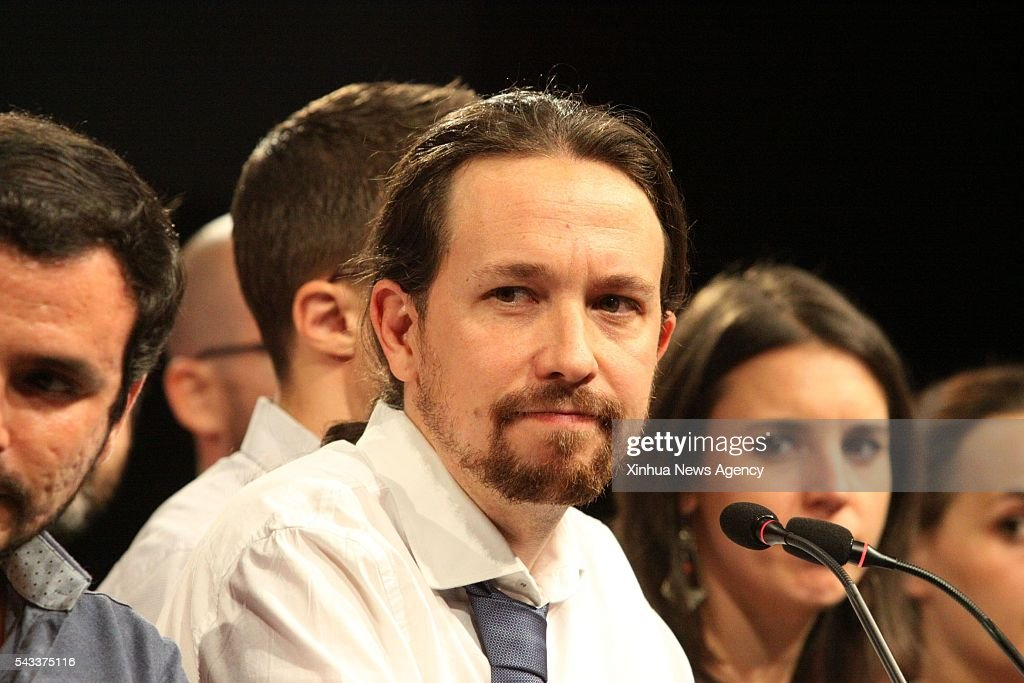 MADRID, June 27, 2016 -- Unidos Podemos leader Pablo Iglesias reacts at the party's headquarters in Madrid, capital of Spain, on June 26, 2016. The People's Party of Spain's acting Prime Minister Mariano Rajoy has won most seats in the general election on Sunday, preliminary results have showed.