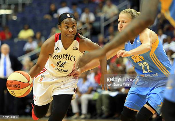 Ivory Latta of the Washington Mystics bursts past Courtney Vandersloot of the Chicago Sky during a WNBA game at Verizon Center in Washington DC...