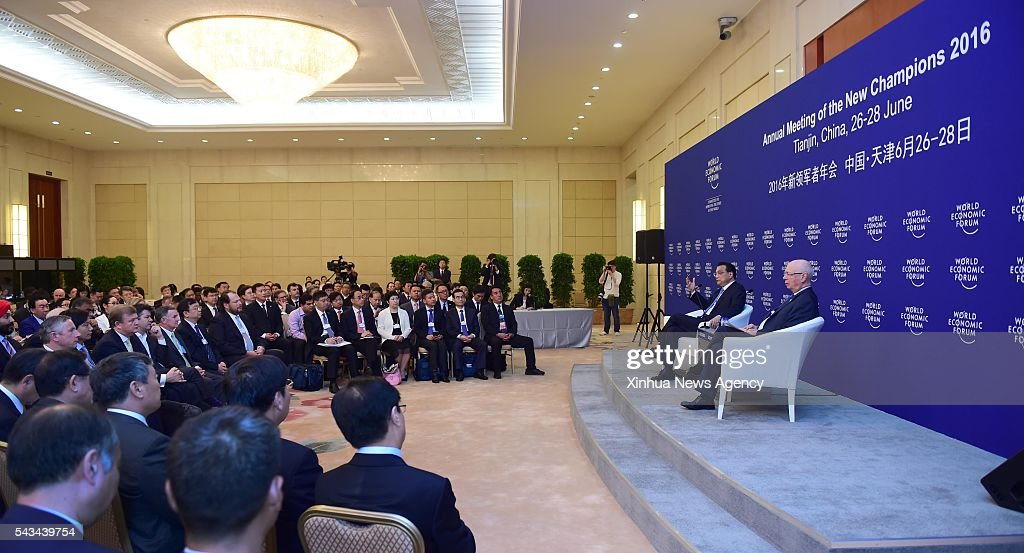TIANJIN, June 28, 2016 -- Chinese Premier Li Keqiang, second right, holds talks with business executives attending the Annual Meeting of the New Champions 2016, or the Summer Davos Forum, in Tianjin, north China, June 28, 2016.