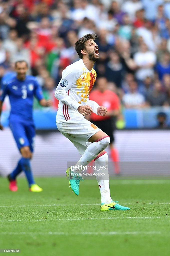 PARIS, June 28, 2016 -- Gerard Pique of Spain reacts during the Euro 2016 round of 16 football match between Spain and Italy in Paris, France, June 27, 2016. Italy won 2-0.