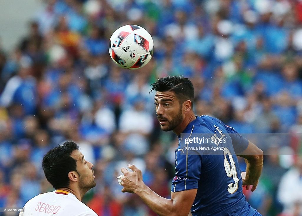 PARIS, June 28, 2016 -- Graziano Pelle, right, of Italy competes during the Euro 2016 round of 16 football match between Spain and Italy in Paris, France, June 27, 2016.